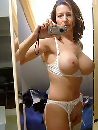 Blondie older prostitute is getting naked on picture